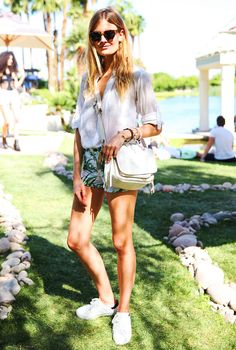 Constance Jablonski in a white lightweight button-down tucked into tropical print shorts, and white sneakers // Coachella 2015