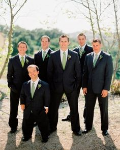 These guys are sporting green ties in different patterns and thistle-and-olive branch boutonnieres to accent their suits