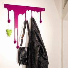 DROP – a series of functional ornaments for walls and any other flat surfaces. It offers you an innovative and ideal possibility, to give naked walls a new look – with colourful and user-friendly hooks that seem to flow.  I must have this.