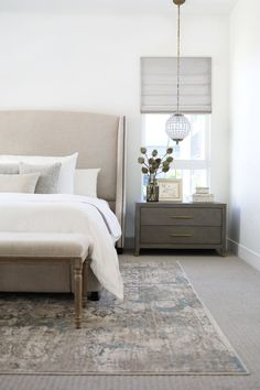 modern farmhouse bedroom design, neutral bedroom decor with upholstered headboard and white bedding with modern pillows, nightstand decor, nightstand styling with artwork over bed, neutral rug in master bedroom decor with bench at end of bed Neutral Bedroom Decor, Serene Bedroom, Warm Bedroom, Master Bedroom Design, Home Decor Bedroom, Bedroom Furniture, Bedroom Designs, Light Master Bedroom, Bedroom Bed