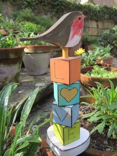 Emanuel Sammut Artist facebook page Wooden owl on love cubes. The owl is hand crafted from red beech wood. The love cubes are hand crafted from tulip wood and hand painted to a distressed finish. Timber comes from sustainable sources.