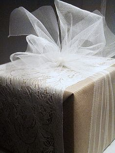 Tulle ribbon over kraft paper