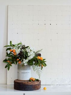 Love the combination of including fruits in a flower arrangement. (Bringing Nature Home 4)