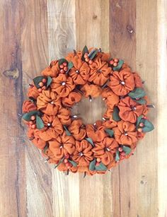 Use this beautiful Burlap Pumpkin Wreath in a variety of ways, but especially in your autumn decorating. Note the small berries used to accent the small burlap pumpkins used to give this wreath de Mesh Ribbon Wreaths, Fabric Wreath, Burlap Wreaths, Painted Pinecones, Painted Pumpkins, Halloween Decorations, Christmas Decorations, Halloween Fun, Burlap Wreath Tutorial