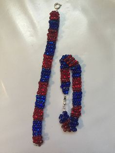 Excited to share the latest addition to my #etsy shop: Jewelry Bracelet Ladder Stitch Sports Red and Blue Buffalo Bracelet Sports Bracelet Barrel Bead Bracelet Buffalo Jewelry Czech Beads Jewelry http://etsy.me/2CGywbI #jewelry #bracelet #sportbracelet #buffalobracelet