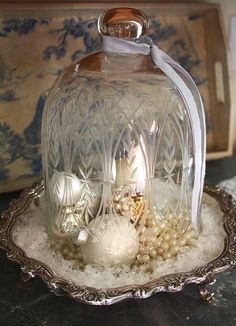 Click here ➤ http://CARLAASTON.com/designed/decor-under-glass for 18 beautiful examples of the magic created when decor is placed under glass! (Image credit:flickr.com)