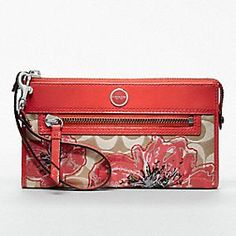 According to Sonia Ramos-Valencia...the last Coach wallet I posted (the one with purple) is a knock off. Far be it for me to take away from the REAL Coach designer. We all LOVE bargains, but quite frankly, I really DO love the REAL THING!! This one is directly from the Coach site.
