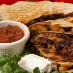 Black Bean and Corn Quesadillas This was very tasty and easy to make.. I used a little taco seasoning instead of brown sugar and red pepper flakes.
