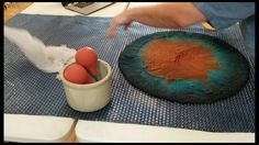 Hand felted vessel with cutaway resist