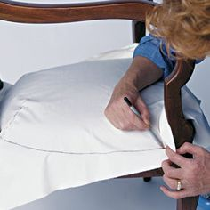 How to slipcover a chair...complete, step by step instructions from making a muslin pattern to actually showing the slipcover