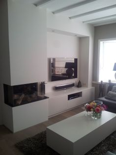 Prachtige tv kast inclusief gashaard en salontafel op maat gemaakt. Verkrijgbaar bij www.michilsen-wonen.nl