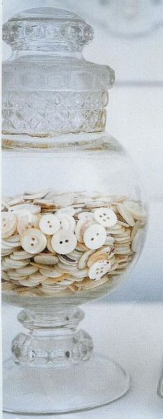 a jar of buttons, safety pins, clothes pins...