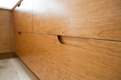 routed-out plywood kitchen cabinet handles