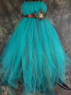 Peacock Tulle Girls dress by TheCreatorsTouch on Etsy, $50.00 Add some pink, minus the peacock feather and i've got my flower girls dress!