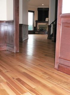 Natural quarter sawn red oak floors - no stain. We'll see if ours come out like this!!