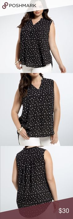"""Torrid Skull Georgette Blouse The super-hot skull trend gets sophisticated. This semi-sheer top is all business with its center front placket, Mandarin collar, and double breast pockets. Black and white skull and diamond print graphics lend a contemporary touch.   Model is 5'8"""", size 1 Size 1 measures 31 1/4"""" from shoulderPolyester torrid Tops Blouses"""
