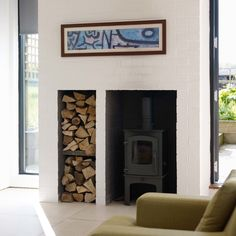 Cool wood burning stoves for sale in Living Room Contemporary with Wood Burning Stove next to White Painted Brick alongside Wood Burning Stove Mantels and Wood Stove Hearth