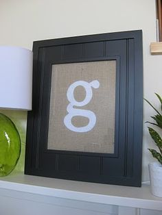I like the dark frame with white lettering...this would stand out on our light kitchen wall...