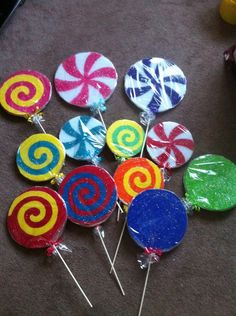 DIY lolly pops to attach  around each tent pole? Or back drop of tent?