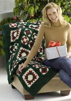 A Cheery Christmas Noel Afghan | AllFreeCrochet.com  This might be cute with all big squares and maybe some solid ones in between.