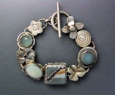 Sterling silver bracelet with opal and grey and blue stones.