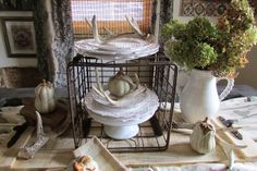 Rustic & Refined: Pallets, Pumpkins and Antlers - neat layered vignette idea with a wire basket