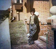 Charlie Chaplin, in color, photographed outside of his studios on La Brea Avenue, Hollywood, 1918. These early color photos were made by a process called autochrome. Inventedby the Lumieres, it was the first practical process that simulated color without the hand-tinting of an artist.