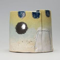 This is a slab built vessel by Craig Underhill which he has decorated with incised lines, engobe, underglaze and glazed. Craig has placed two enamel dots on this pot - one on either side.