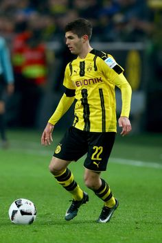 Christian Pulisic of Dortmund runs with the ball during the Bundesliga match between Borussia Dortmund and Borussia Moenchengladbach at Signal Iduna Park on December 3, 2016 in Dortmund, Germany.