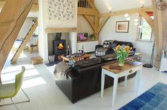 Oak frame sitting room in Cornish barn house