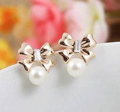 Silver, Platinum, Gold - Righteous from Skreened. Fashion Earrings, Fashion Jewelry, Best Bow, Bow Accessories, Jewelry Trends, Fashion Beauty, Fine Jewelry, Pearl Earrings, Bling