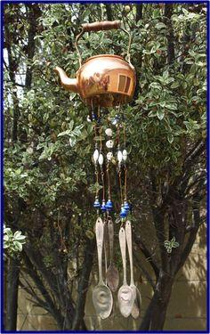 Vintage brass tea pot wind-chimes with flattened  metal spools on Etsy, $30.00