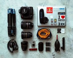 WHAT'S IN MY TRAVEL/ CAMERA BAG?!? I recently get a lot of question on my equipment and what I pack for traveling. So I though I would simply post a photo of my most common used equipment to refer to!  I shoot with a Nikon D610 because it is an Allrounder! Low light sport or studio it pretty much is able to handle all of my needs very well! And of course it's full frame. I always travel with 4 Batteries which gets me through 15 hours continues shooting! My lenses are: The Nikon 50mm 1.8…