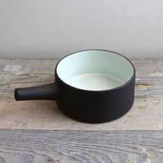 "looksLike: open top kettle, hold by ""handle"", which becomes a spout to pour out of  Vintage Dansk Flamestone Casserole"