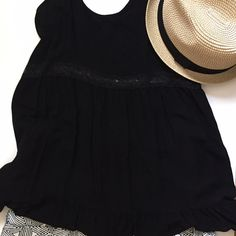 Black Sleeveless Ruffled Tank Anything black is always a must! This tank has a cute ruffled bottom with lace that runs below the bust line (front & back). BNWOT. Bought but never worn. Soprano Tops Tank Tops
