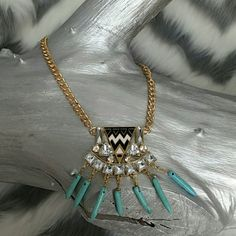 "Global Festival necklace! Brand new Gorgeous faux turquoise stone, silver rhinestone and black and white chervon print make this necklace a smashing success!! A wonderful gift for yourself or someone you love!! Gold metal 17""chain with 3"" extension Jewelry Necklaces"