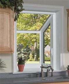 A garden window lends itself to growing all types of things and adding to your view when in the kitchen cooking!