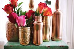 Copper spray painted bottles into vases Spray Painted Bottles, Spray Paint Mason Jars, Copper Spray Paint, Painted Mason Jars, Metallic Paint, Paint Bottles, Gold Spray, Gold Paint, Cool Diy Projects