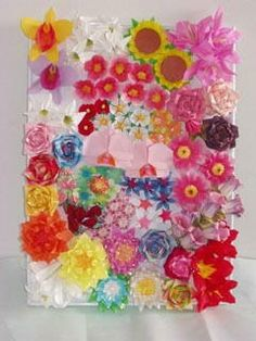 Origami flower board.  Make your own, pin it to the wall.