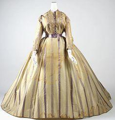 "Dress: ca. 1865, French, silk, wool.    Marking: [label] ""Mme. Marguerite Robes, 6 rue de Miromenil, Paris"""