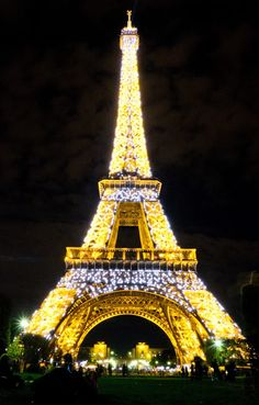 Eiffel Tower evening lights in Paris.  The light show goes off every hour from dusk to midnight.