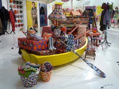 Amazing covered props centred display at Boden 2011 winter preview Love this row boat as a store prop!