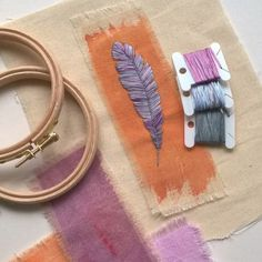 thethreadedneedle:A hand embroidered feather on hand painted...