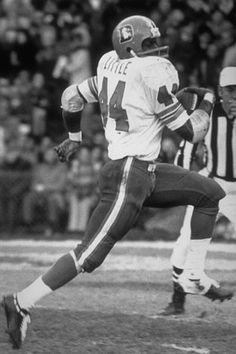 WHEN THE DENVER BRONCOS HAD NO ONE, NOT A SINGLE REAL PLAYER AMONG THEM, THEY DRAFTED A BOW-LEGGED RUNNING BACK FROM SYRACUSE NAMED FLOYD LITTLE, AND FROM THAT POINT FORWARD UNTIL SOMETIME AROUND 1976-1977, FLOYD LITTLE WAS THE DENVER BRONCOS.