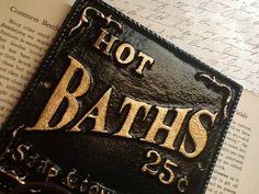 Jet Black Bathroom Hook - Cast Iron Sign -Metal Wall Hook-Bathroom Hook -Fixture -Ebony Black-Shabby Chic Decor-French Decor-Gold Letters. $19.95, via Etsy.