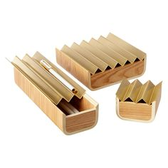The art of organization begins with these flower-inspired boxes. Crafted of bent plywood - a mid-century modern favorite - they're perfect for jewelry, cufflinks, offices supplies or art materials. The solid heavy-weight brass lid cradles frequently used items for quick access and when empty, adds a beautiful note to a desktop, dresser or coffee table.