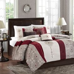 For an updated look, the Donovan collection will make a statement in any home. The comforter and sham features a unique deep red and chocolate brown geometric pattern is print on soft microfiber and reverses to solid red. The geometric motif is enlarged and embroidered asymmetrically on the comforter and accented with stripe details. The set includes a solid brown bedskirt. The three decorative pillows includes embroidery and pleating details in deep red and rich brown colors.