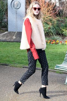 On Olivia Palermo: Chloé vest, top, and pants; Moncler sunglasses; Tabitha Simmons Harmony Boots ($475).