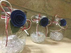 Beautiful Mason jar lantern. These glass Mason jars are adorn with white and red twine and a blue burlap flower. They are filled with clear crystals and include a tea light. Perfect for table decorations for get togethers. These have a patriotic and classy appeal. Three available.
