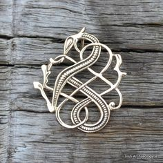 This distinctive Urnes-style dragon pendant is... - Ancient Ireland